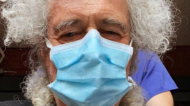 Brian May blames 'over-enthusiastic gardening' for butt muscle injury