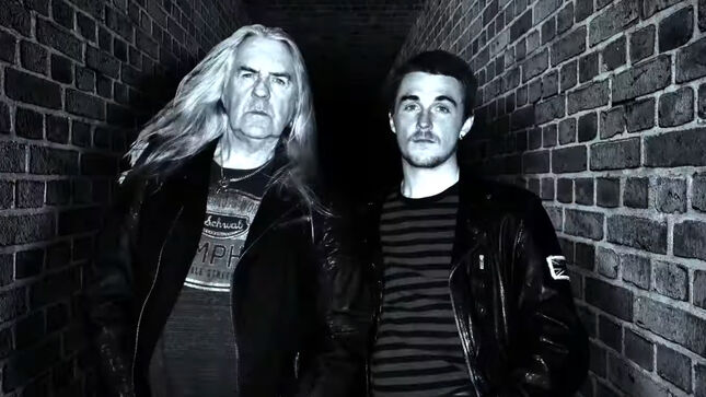HEAVY WATER Feat. SAXON Frontman BIFF BYFORD And Son SEB BYFORD To Release Debut Album, Red Brick City, In July; First Single And Video Out Friday (Trailer)